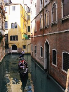five-person-in-venetian-gondola-with-gondolier