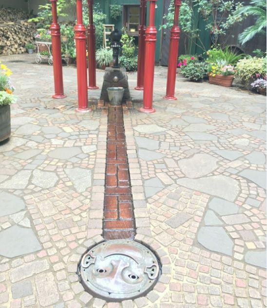 ghibli-museum-garden-well-manhole