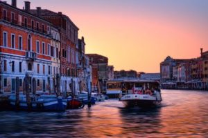 venetian-water-bus-travelling-in-the-sunset