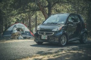 black-smart-car-on-pavement