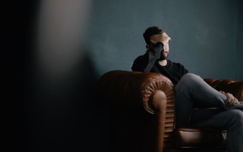 frustrated-man-sitting-on-the-couch