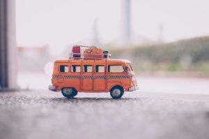 orange-die-cast-model-van-on-pavement