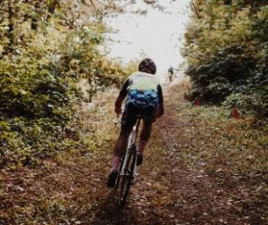 person-climb-up-mountain-path-with-road-bike
