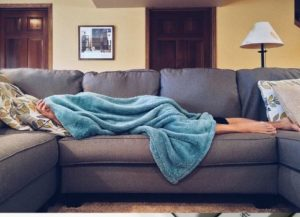 person-lying-on-sofa