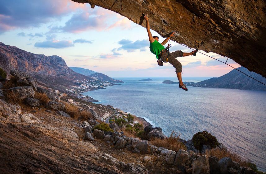 man-climb-up-rock-overhang